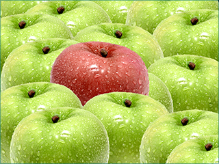 one red apple among many green apples